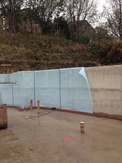 Basement Waterproofing Membrane Being Applied To The Buildingu0027s  Water Resistant Concrete Shell
