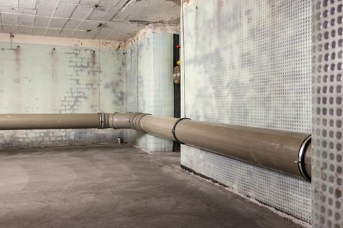 A basement with walls prepared using cavity drain membrane