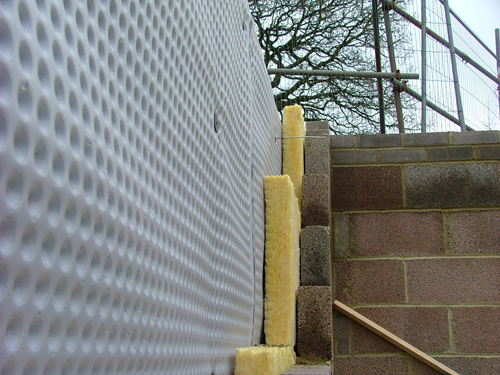 A wall prepared with cavity drain membrane waterproofing and insulation